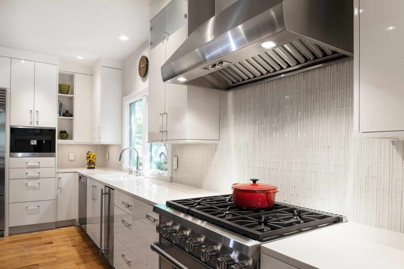 Chrome and Cream 3 beautiful and functional kitchen with vented gas range cooking