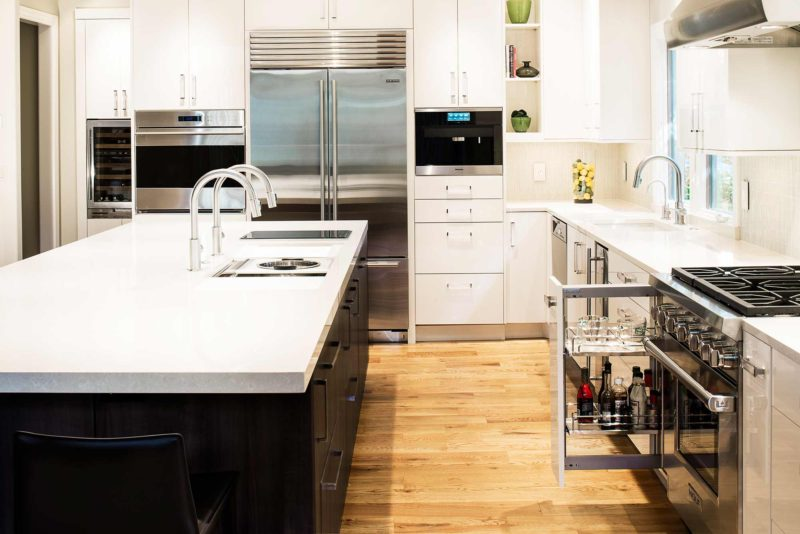 Chrome and Cream 9 beautiful and functional kitchen with pullout storage for oils and spices for cooking