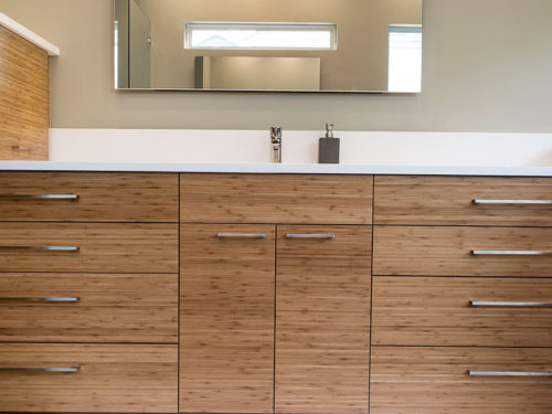 Beyond the Kitchen 4 modern bathroom counter with wood grain cabinets and modern vanity mirror