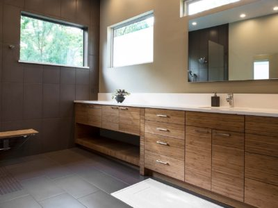 Beyond the Kitchen 7 modern bathroom counter with wood grain cabinets and modern vanity mirror