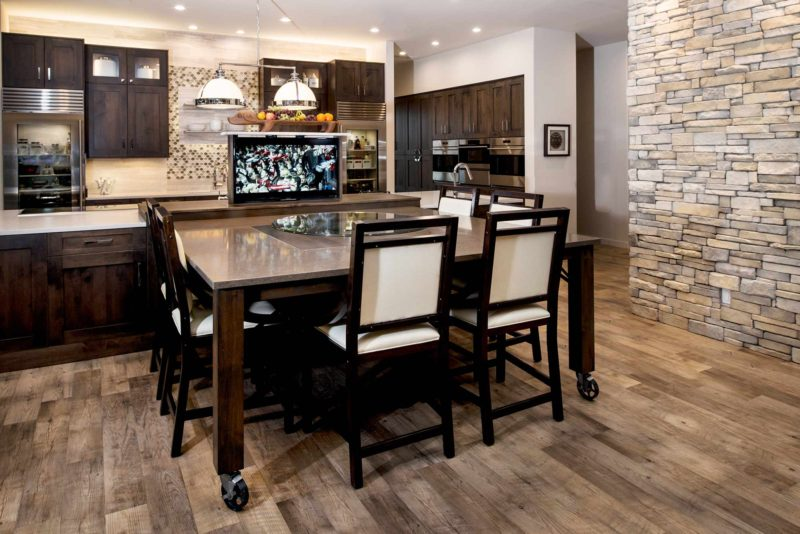 Heart of the Treehouse 1 modern kitchen featuring roll away table and pop up television in the island
