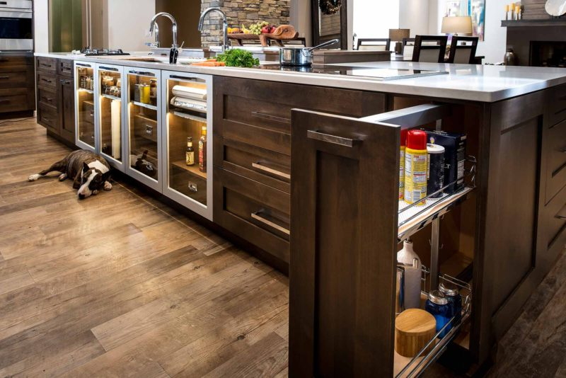 Heart of the Treehouse 12 modern kitchen with pullout pantry storage in the island