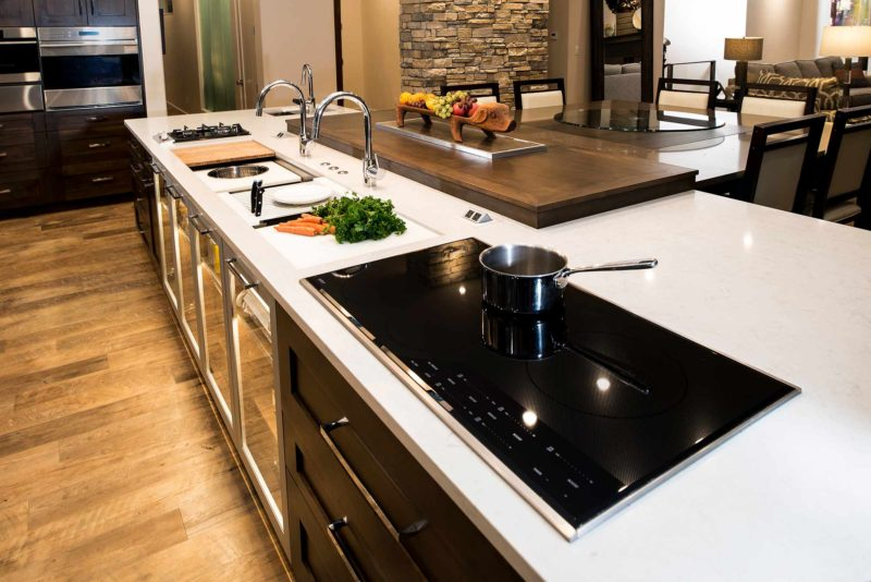 Heart of the Treehouse 4 modern kitchen with Galley Workstation large kitchen sink and induction cooking on the island