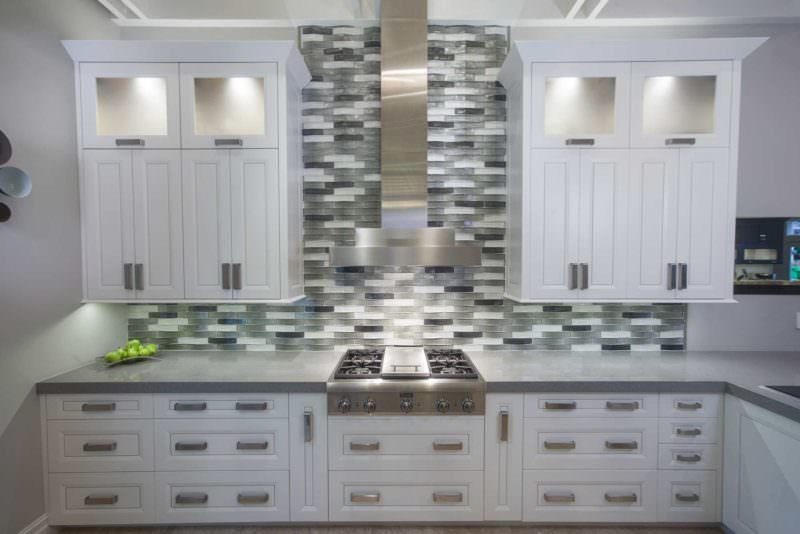 Leaves You Jonesin 2 contemporary kitchen with Thermador gas range top, vent hood above and tile backsplash